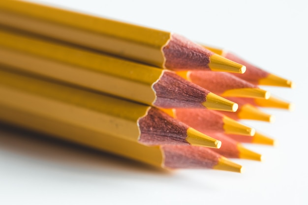 Yellow pencils on a white background. office, drawing.