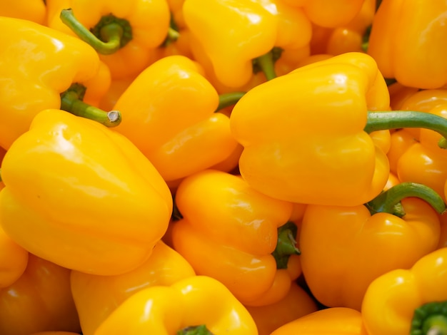 Yellow peppers in the mall. in the mall. vegetarian food.