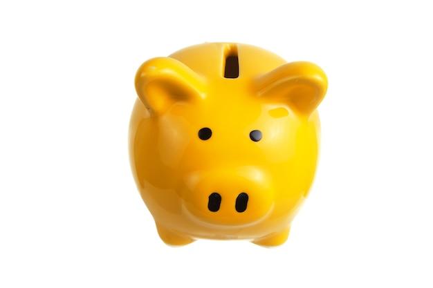 白い背景に黄色の貯金箱