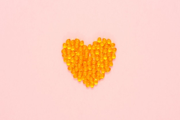 Yellow pills arranged in a shape of heart
