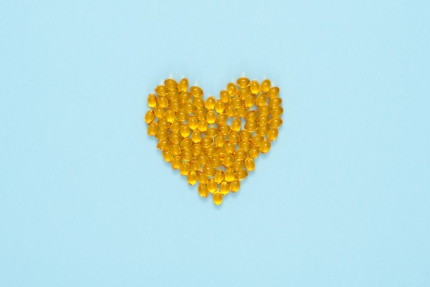 Yellow pills arranged in a shape of heart