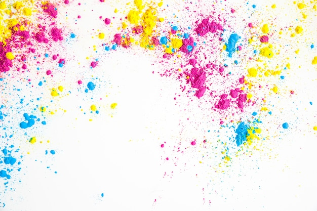 Yellow; pink and blue color powder on white background