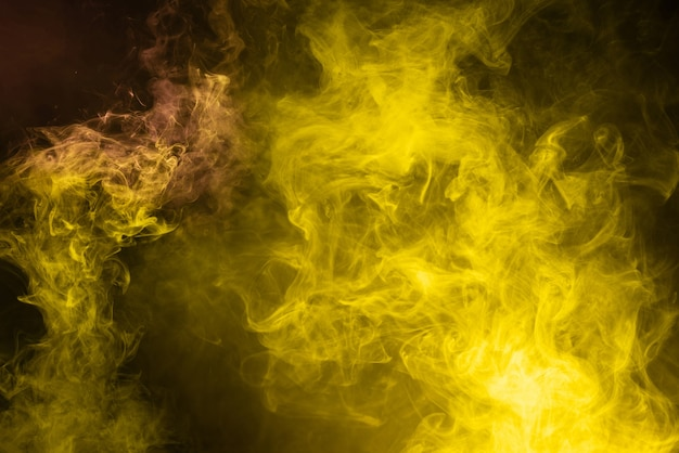 Yellow and pink steam on a black background. copy space.