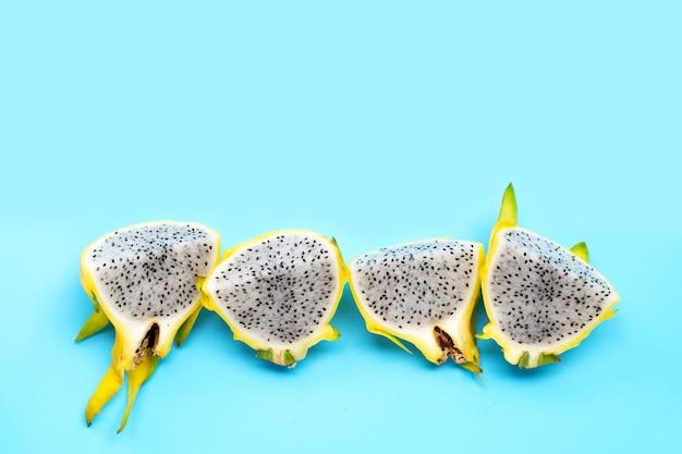 Yellow pitahaya or dragon fruit on blue