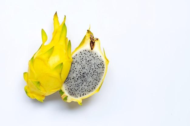 Yellow pitahaya or dragon fruit on white. copy space