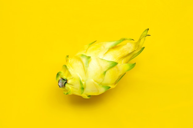 Yellow pitahaya or dragon fruit on yellow background.  top view
