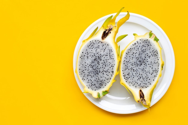 Yellow pitahaya or dragon fruit on yellow table