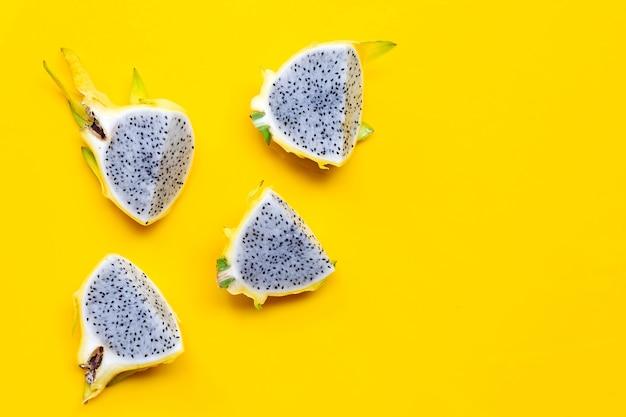 Yellow pitahaya or dragon fruit on yellow