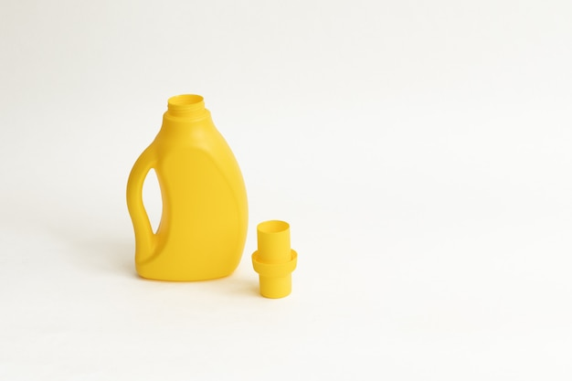 Yellow plactic bottle for detergent on a white backgraund. open washing gel on white background isolated.