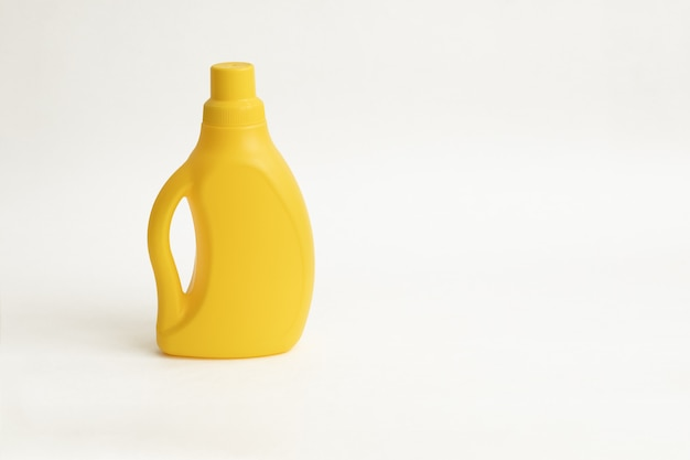 Yellow plactic bottle for detergent on a white backgraund