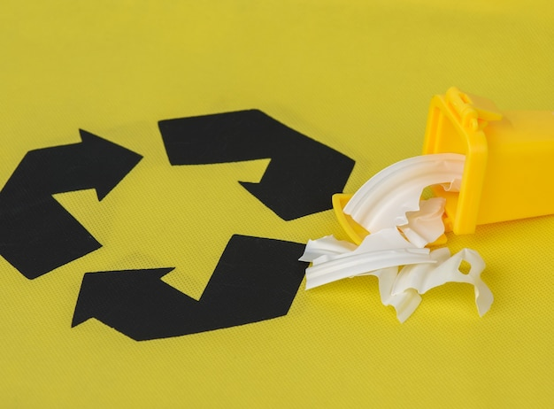Yellow plastic containers yellow , concept of correct sorting of garbage for further recycling