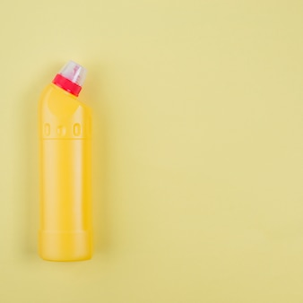 Yellow plastic detergent bottle