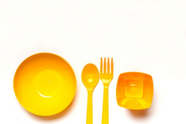 Yellow plastic disposable tableware