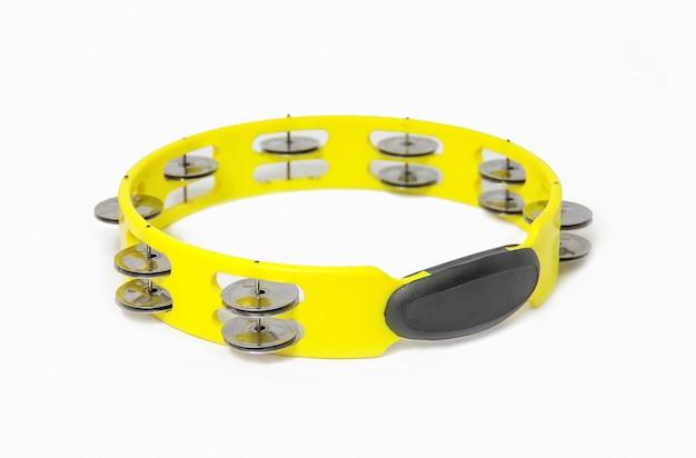Yellow plastic tambourine on white background