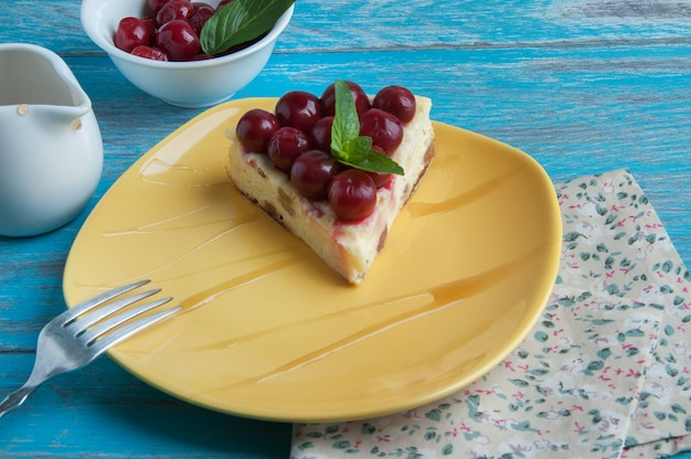 Yellow plate with a piece of cheesecake