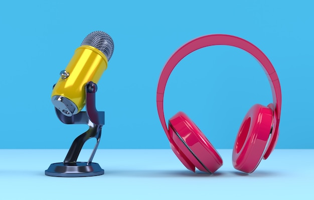 黄色のポッドキャストマイクとピンクのヘッドフォン