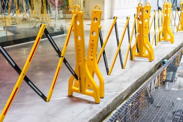 Yellow portable plastic folding safety barrier, traffic fence, yellow fence