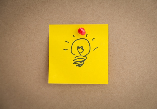 Yellow post-it with a drawn bulb