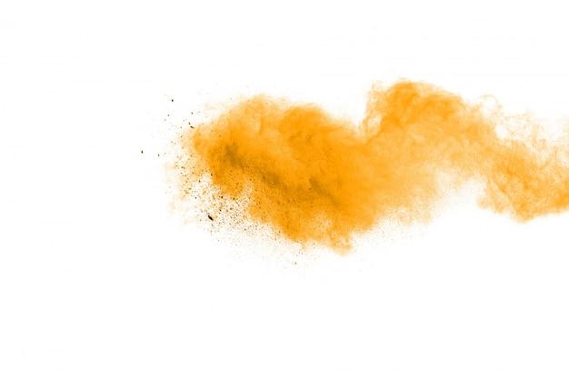Желтый порошок взрыв, изолированных на черном фоне