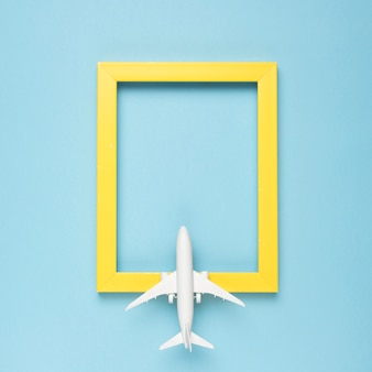 Yellow rectangular empty frame and airplane