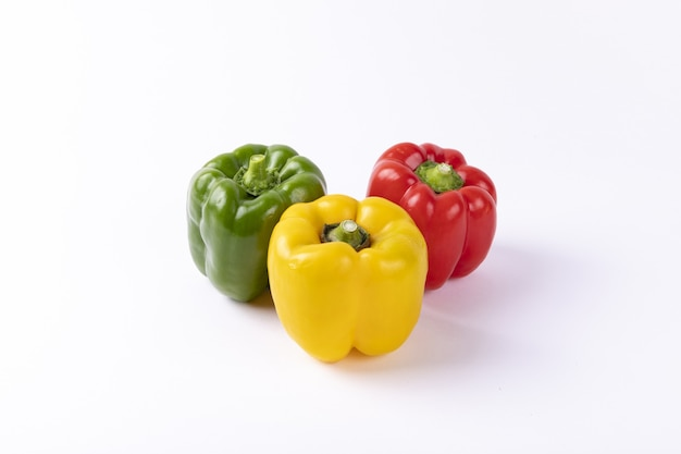 Yellow, red, and green bulgarian pepper isolated on a white table