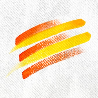 Yellow and red paint stains on canvas