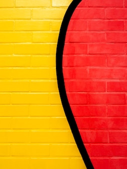 Yellow and red painted brick wall background. empty space on vivid color brick wall texture, vertical style.