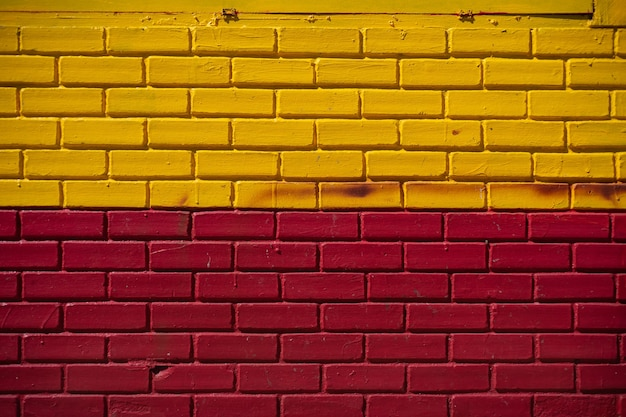 Yellow and red red wall texture background