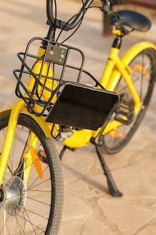 Yellow rental bike parked in city