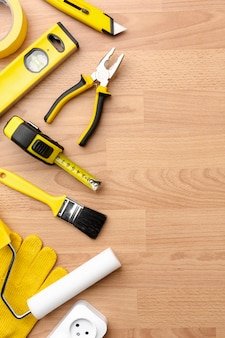 Yellow repair kit on wooden background