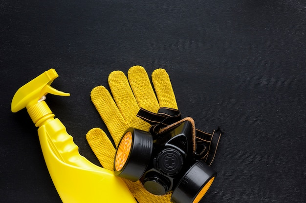 Yellow repair spray and gloves with dust mask