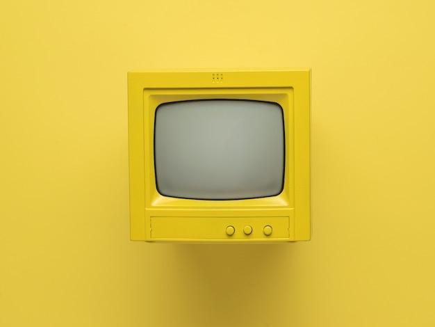 노란색 배경에 광선 튜브가 있는 노란색 복고풍 모니터. 플랫 레이.