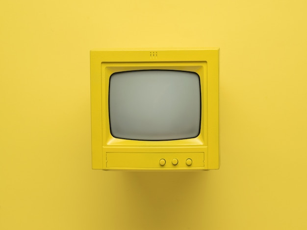 Yellow retro monitor with a ray tube on a yellow background. flat lay.