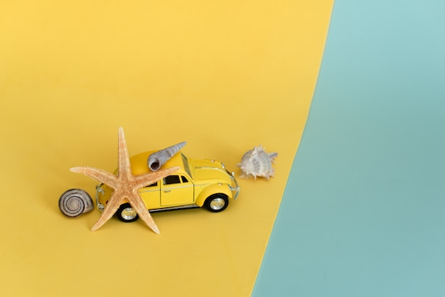 Yellow retro toy car on yellow
