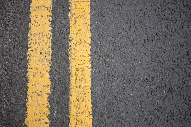 Yellow road marking on road surface