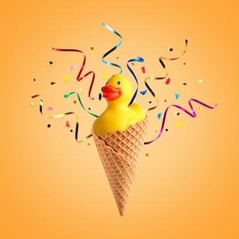 아이스크림 콘 및 밝은 배경에 파티 깃발 노란색 고무 오리.