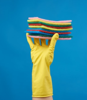 Yellow rubber glove for cleaning is put on his hand, part of the body is lifted up