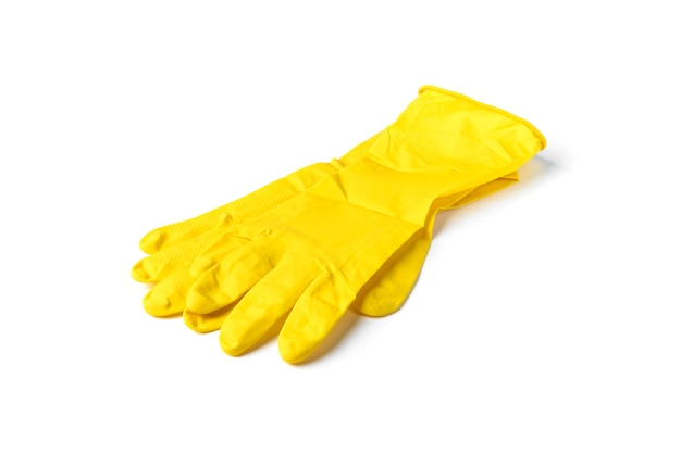 白い背景で隔離の黄色のゴム手袋。