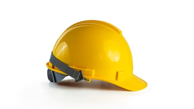 Желтая защитная шляпа, изолированные на белом фоне