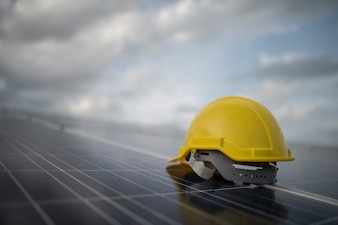 Yellow safety helmet on solar cell panel