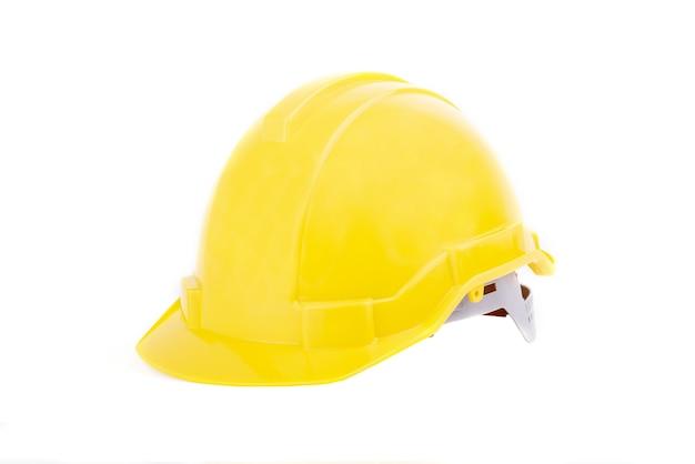 黄色の安全ヘルメットまたは白い背景で隔離のハード帽子