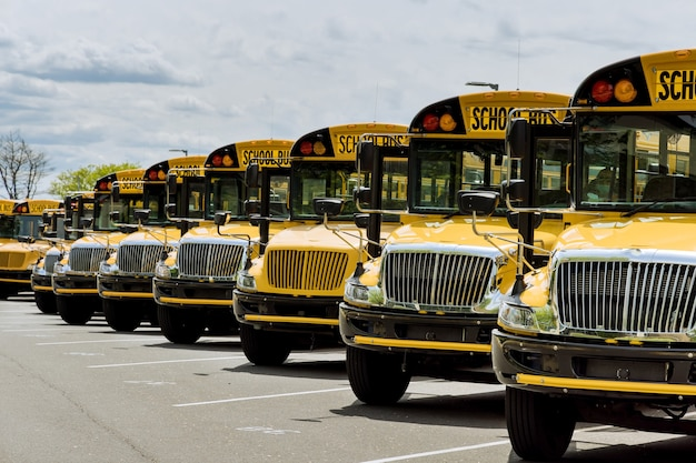 Yellow school buses parked near the high school