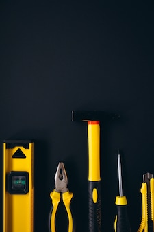 Yellow set of tools on black background