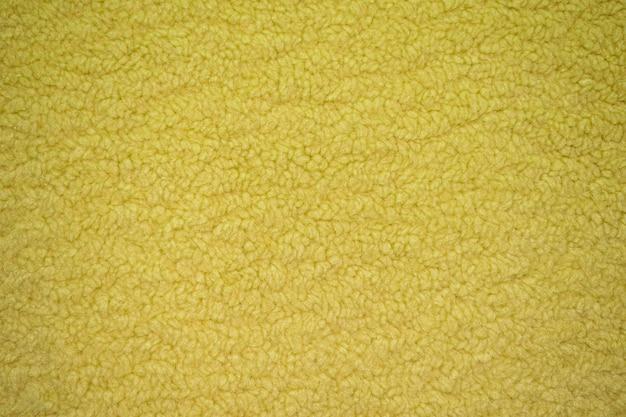 繊維の質感のある黄色い羊の毛皮さまざまな目的のための柔らかいキャンバスのパターン