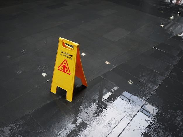 Yellow sign of cleaning in progress on wet floor