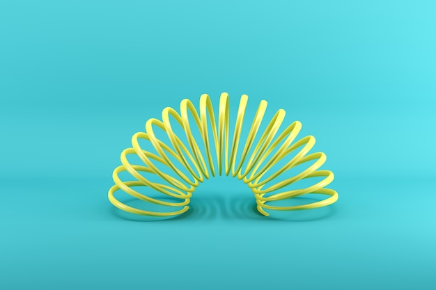 Yellow slinky isolated on blue