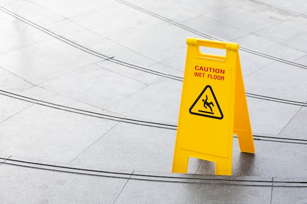 Yellow slippery warning safety caution sign