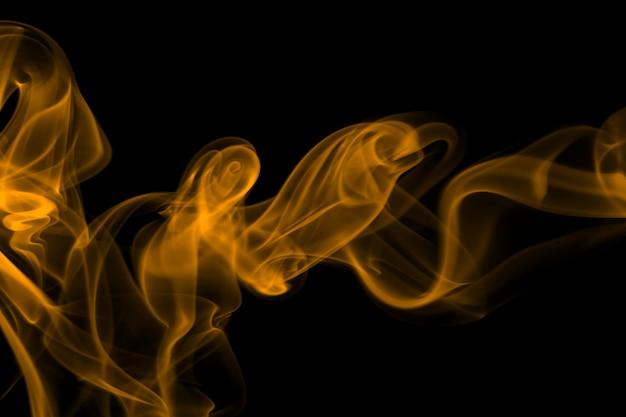 Yellow smoke abstract on black background