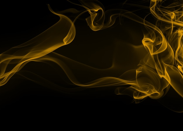 Yellow smoke abstract on black background