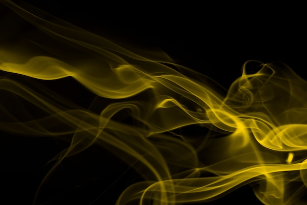 Yellow smoke abstract on black
